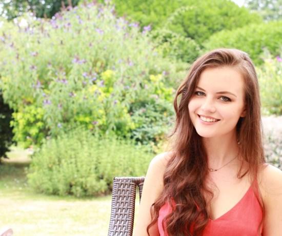 Brunette haired teen against garden background