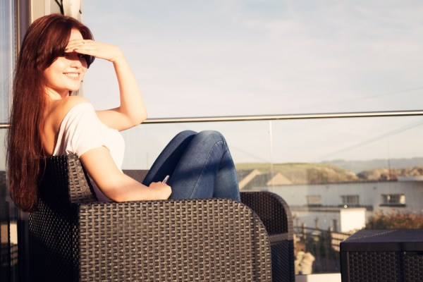 girl-chilling-on-balcony