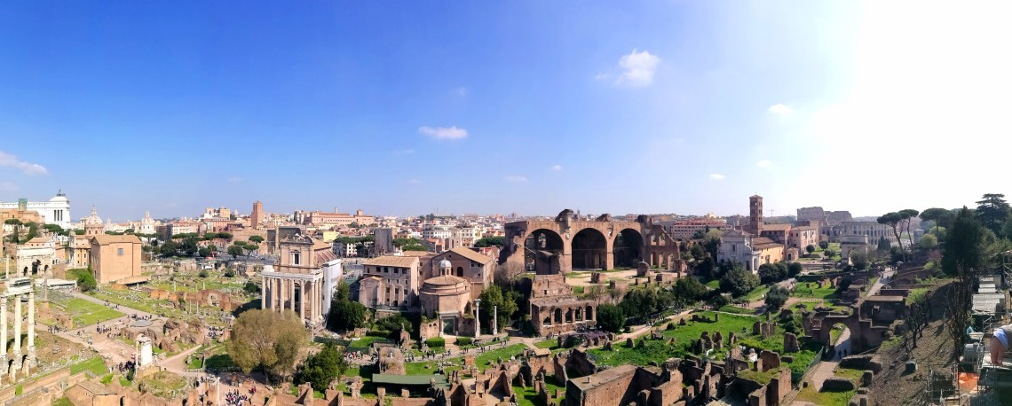 Panorama photograph of Roman Forum Rome Italy. Blue sky. Sunny day.