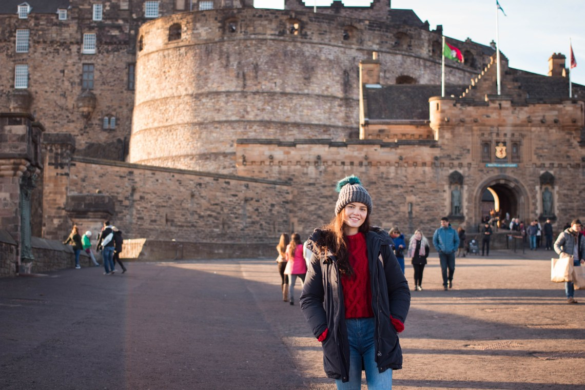 Young woman standing in front of Edinburgh Castle