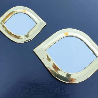 miroirs en laiton doré forme oeil