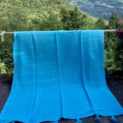 plaid à pompons coton bleu lagon
