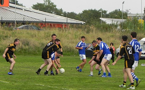 Two gaelic teams fight for the ball