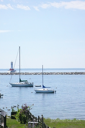 There are also many sailboats in the harbor and around the island. Here you can see the more modern Mackinac Lighthouse.