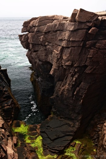 Thunder Hole in Acadia is a place where water crashes agaisnt the rocks - shooting high into the air.
