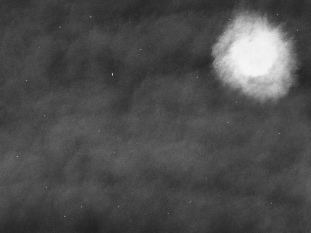 The Moon at Night Behind Clouds