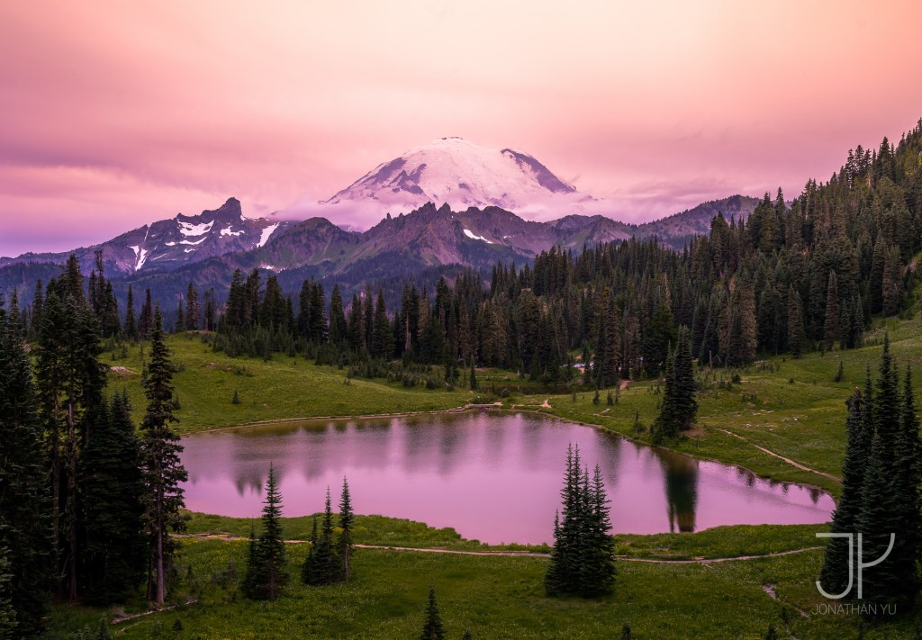 Tranquil sunset at Tipsoo Lake as forest fires bring thick waves of smoke