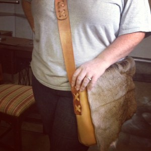 Leather and deer fur satchel