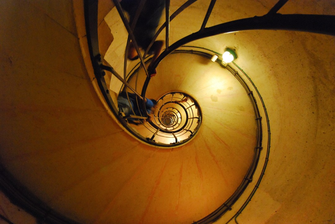 Up the spiral staircase inside the Arc de Triomph