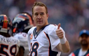 Dec 22, 2013; Houston, TX, USA; Denver Broncos quarterback Peyton Manning (18) gives a thumbs up to cheering fans against the Houston Texans during the second half at Reliant Stadium. The Broncos won 37-13. Mandatory Credit: Thomas Campbell-USA TODAY Sports