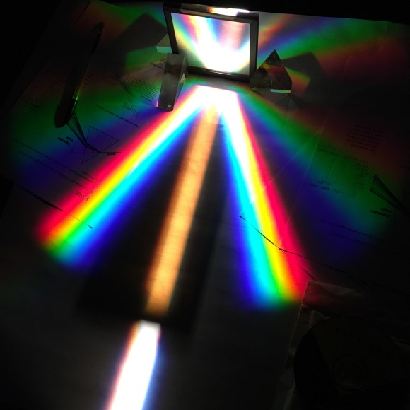 Light is diffracted through a prism, showing all the colours of the rainbow
