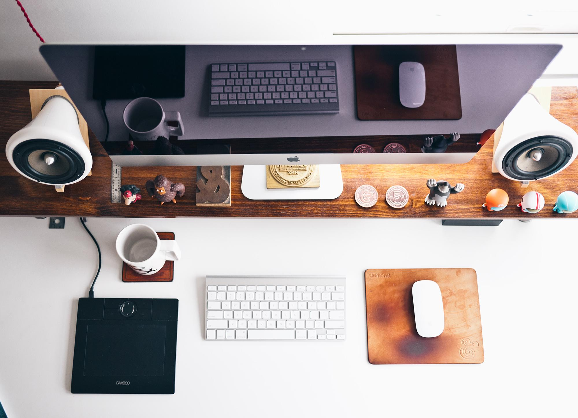 Graphic Design Desk arrangement with Apple computer