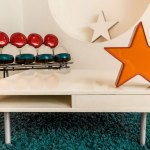 Metal stars and mid-century furniture in downtown Los Angeles loft space