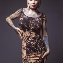 Blonde tattooed fashion model in a Peepshow Clothing dress