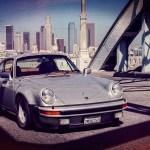 Vintage Porsche 911 driven by Magnus Walker over the 6th street bridge in Los Angeles