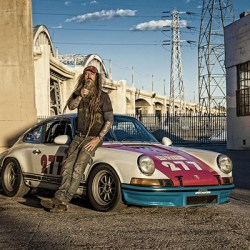 Portrait of Magnus Walker with his Porsche under the 6th Street bridge