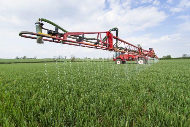 Tractor applying OMEX liquid fertiliser