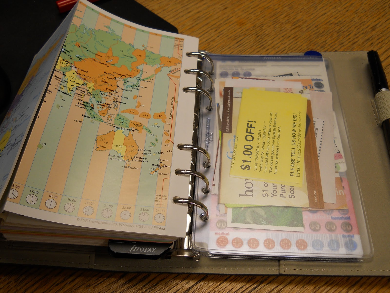 After My Tabses My Address Book (pretty Boring) Then My World Map And  Topopening Envelope That I Use For Coupons The Map Hasn't Proved Useful  Yet,