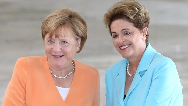Angela Merkel e Dilma Rousseff: a primeira dirige uma economia estável e a segunda, uma economia em frangalhos, devido a erros de seu primeiro governo