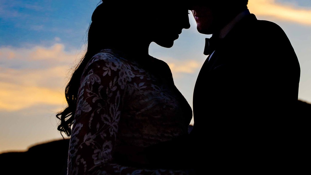 Bride and Groom silhouettes at Sunset