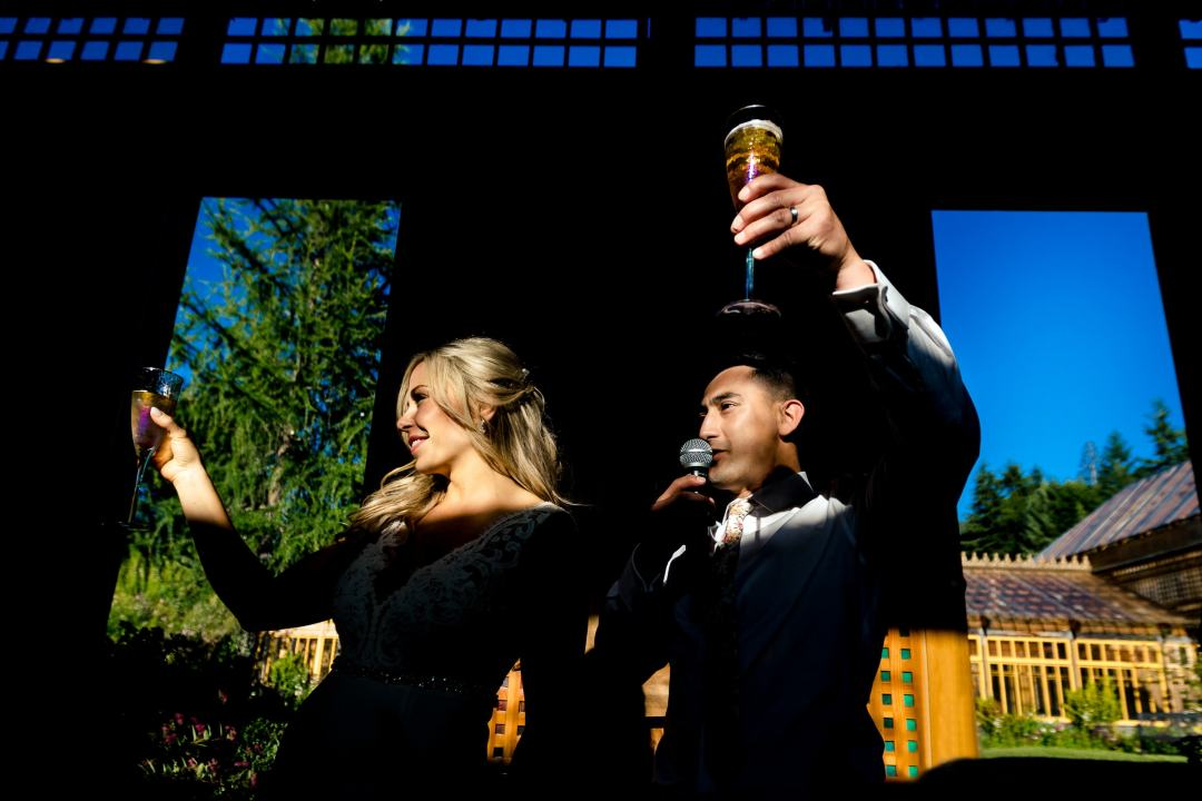 Bride and groom toasting at Mt Hood Organic Farms in Hood River, Oregon