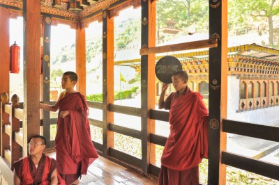Bhutan - Gom Kora temple monks.