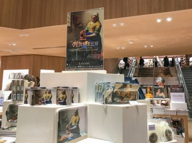 The Louvre gift shop and book store are doing a brisk business in Vermeer memorabilia. (1)