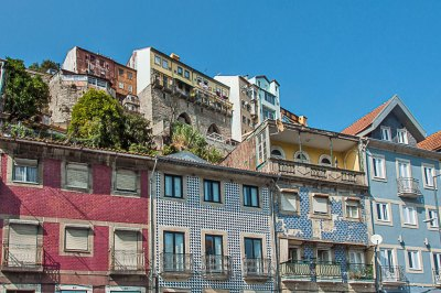 The stacked houses of Ribeira rise from the bluff.