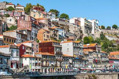 A jumble of skinny houses clings to the cliffs of the old town.