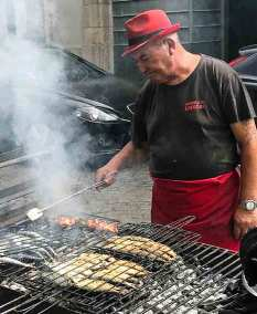 Fish is grilled on charcoals  along the streets of Matosinhos.