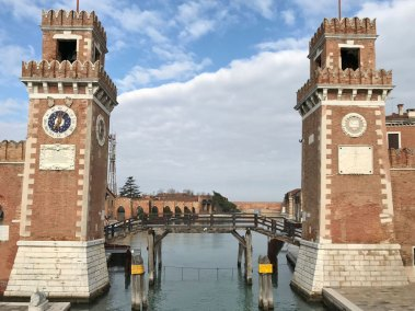 Crenelated towers guard the entrance of the Arsenale.