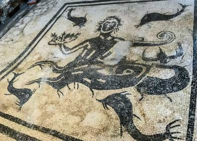 A mosaic floor  with nautical motives decorates the women's baths.