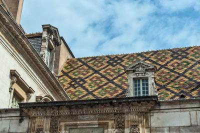 The traditional polychrome roof tiles of Burgundy first appeared in the  13th century.