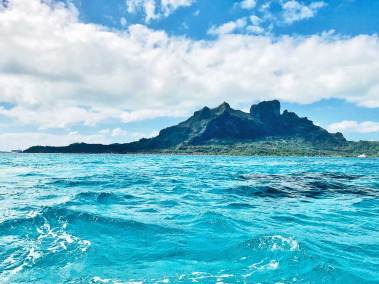 Bora Bora rises from its dazzling lagoon.
