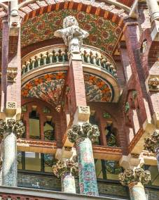 The facade of the Palace of Catalan Music by famed local Art Nouveau architect Lluis Domènech I Montanier, incorporates traditional Spanish and Moorish architectural elements.