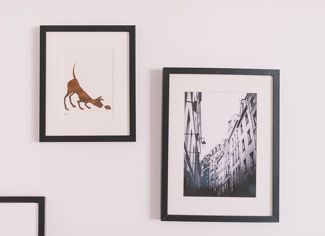 Framed photos hanging on the wall.