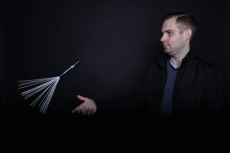 Alex Monroe catching a drum brush