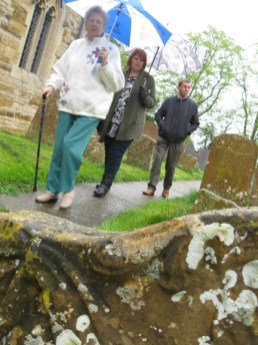 Nan, Toni, and uncle Raymond walk the path at Church of St. Laurence at Brafield on the Green