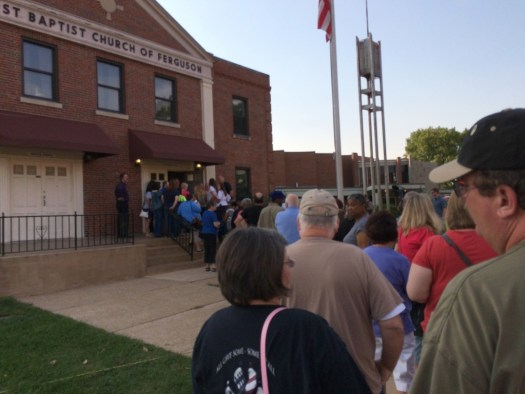 Ferguson residents line up outside First Baptist Church waiting to attend the second DOJ town hall meeting.