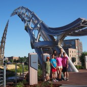 At the dawn of our second day, we took a photo with a cool sculpture in Falls Park, S.D.