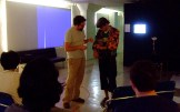 Josh teaches Austin how to operate the jacket controls