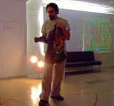 Presenting at Disclocate, with circuit board design in background
