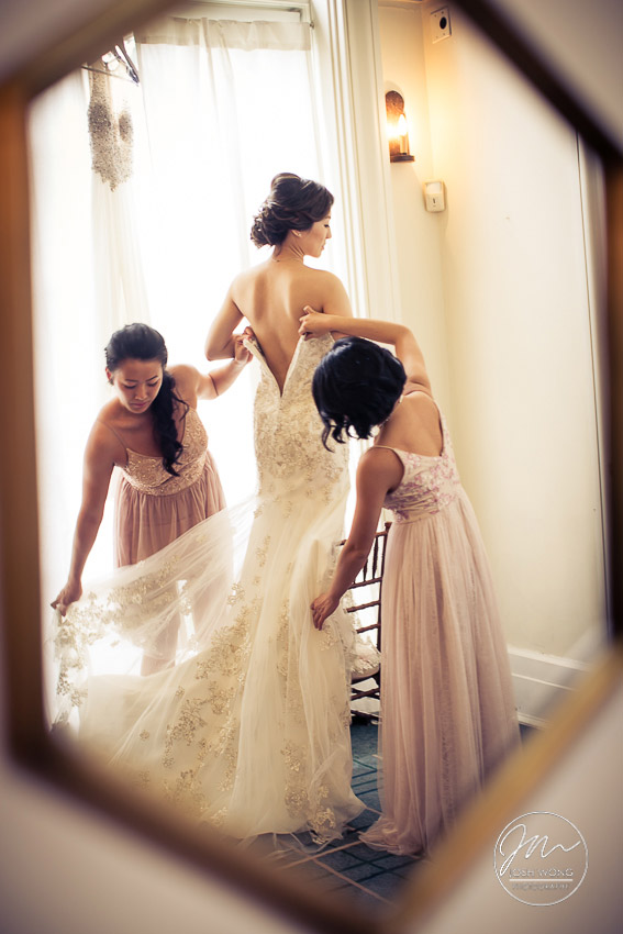 The bride gets into her wedding dress. New York Botanical Garden Wedding Pictures by NYC Wedding Photographer Josh Wong Photography