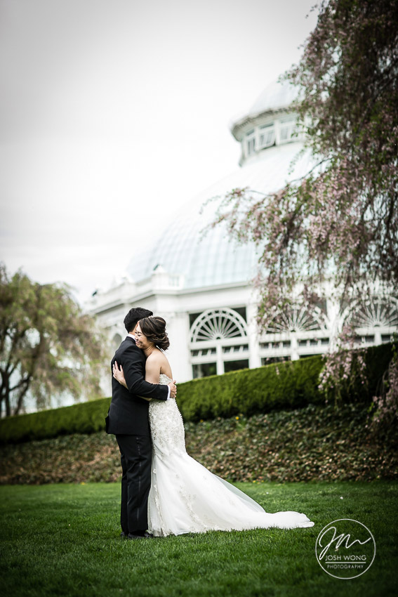 The groom gets a glimpse of the bride for the first time. New York Botanical Garden Wedding Pictures by NYC Wedding Photographer Josh Wong Photography