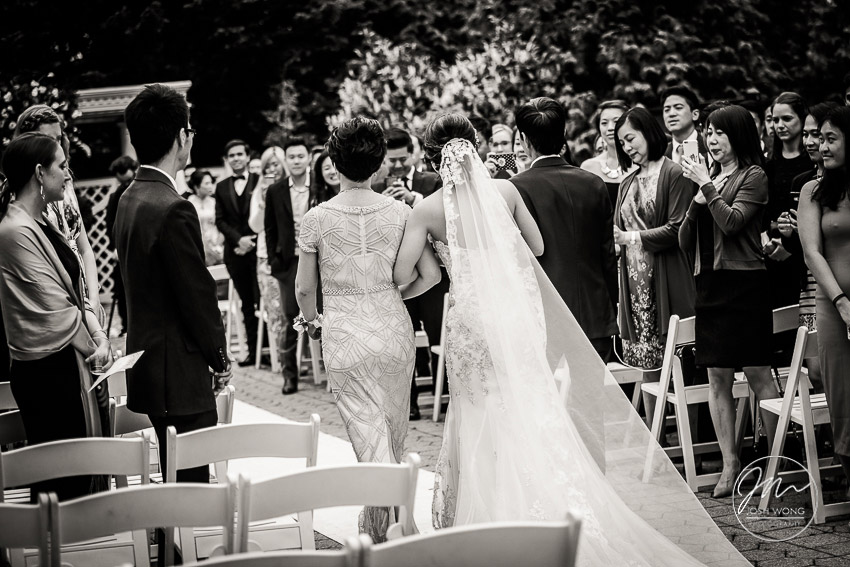 In the moment. The parents of the bride escort their daughter down the aisle.  New York Botanical Garden Wedding Pictures by NYC Wedding Photographer Josh Wong Photography
