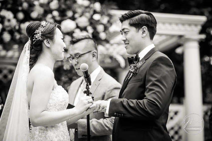 The couple exchange rings while saying their vows. New York Botanical Garden Wedding Pictures by NYC Wedding Photographer Josh Wong Photography