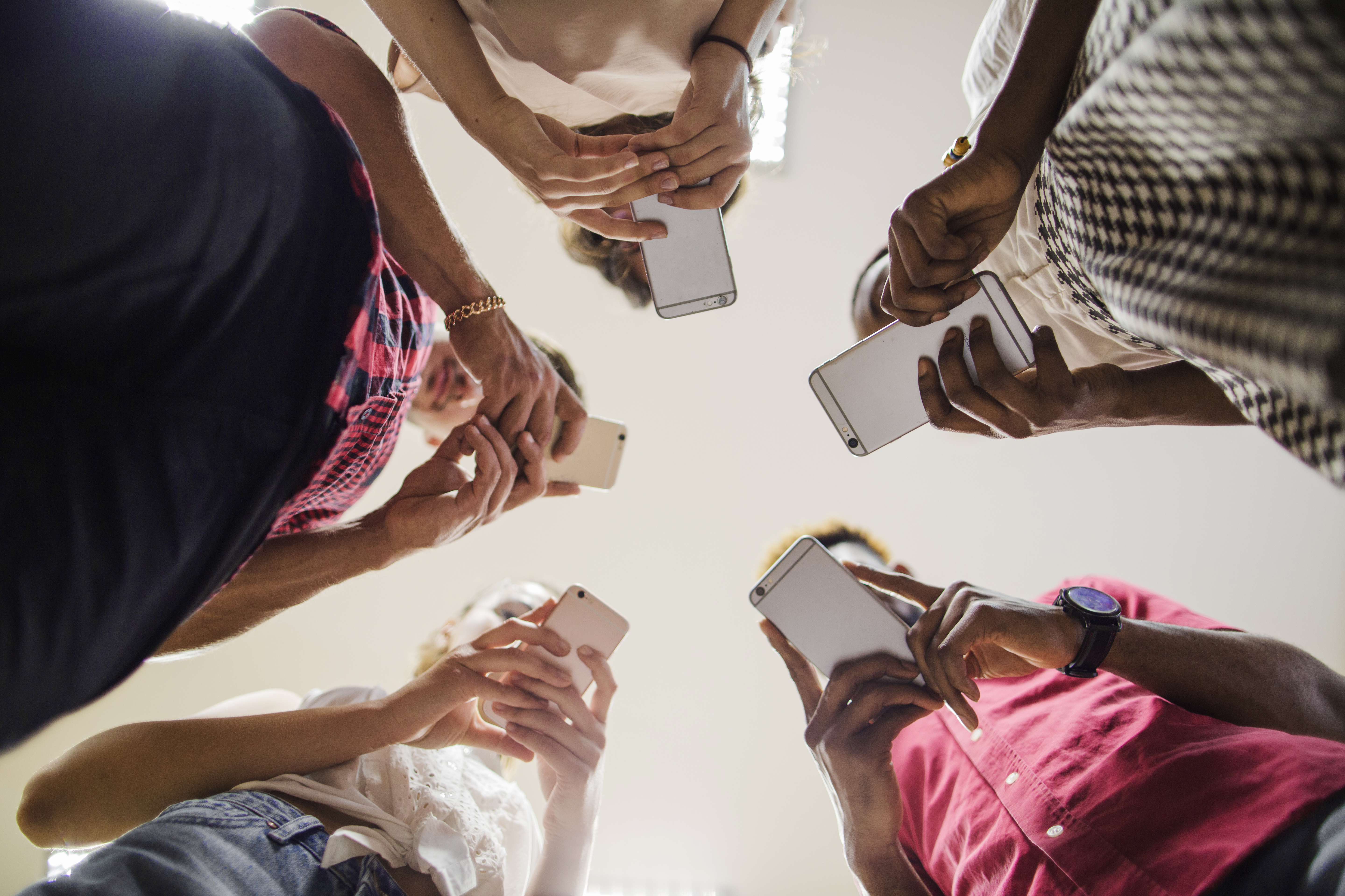 Group of hands holding phones