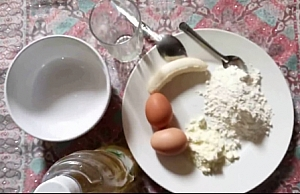 Plate containing 2 eggs, powdered milk, maize (corn) flour and banana as recipes for Infant formula