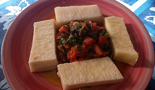 Boiled white yam is served with vegetable sauce