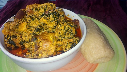 Serve egusi soup with pounded yam or fufu and enjoy your meal